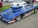 Blue Corvette on the raceway