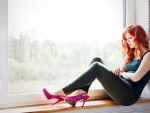 Beautiful girl Redhead in Window