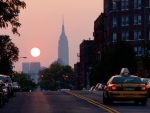 empire state building in the distance at sunset