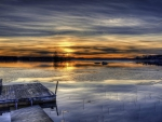 floating raft on a frozen lake at sunset hdr