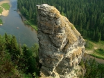 mighty rock pillar by a river