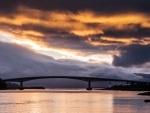 skye bridge in scotland under fiery sky
