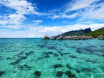Blue Lagoon and Coral Reef under water bungalows Moorea French Polynesia