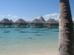 Water Bungalows over Blue Lagoon Moorea Island