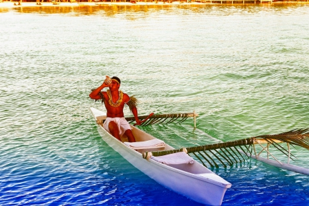 Polynesian Man in Canoe with Conch Bora Bora - canoe, beautiful, sea, lagoon, bora bora, blowing, polynesian, exotic, islands, blow, tahitian, ocean, man, conch, water, paradise, shell, local, island, tahiti, tropical