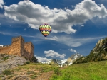 hot air balloon over ancient castle