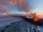 eruptions on a snow covered volcano