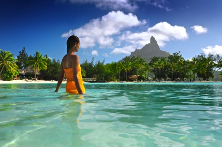 Bora Bora Paradise - polynesia, wade, woman, sea, palm trees, lagoon, bora bora, aqua, blue, exotic, islands, ocean, shallow, water, girl, paradise, swim, island, lady, tahiti, tropical