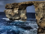 arched rocks in a wild coastline