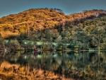 ercall hill in england reflected in lake hdr