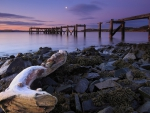 broken pier on a scottish river mouth at night