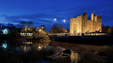 ancient fortress by a river at night - city, boat, fortress, river, lights, night