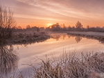 sunrise on a river in winter