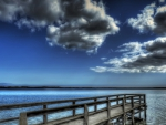 wooden pier in a blue lake hdr