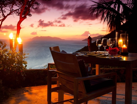 Sunset Table for Two - dinner, sunset, sea, flame, evening, torches, exotic, islands, view, ocean, table for two, candles, paradise, restaurant, dine, island, tropical