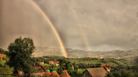 amazing rainbow over rural village - mountains, village, fields, rainbow, rain, overcast