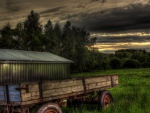field wagon by a tin shed hdr