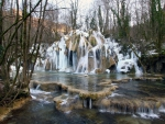 gorgeous cascading waterfall in france in winter