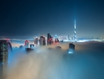 fantastic skyscrapers through the fog in dubai