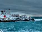 lighthouse on a cape in winter