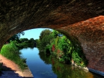 canal under an arched bridge