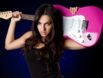 gorgeous brunette and pink guitar