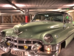 classic cadillac in an underground parking lot hdr