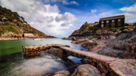 lovely pier and dock in the village of polperro england - rocks, dock, pier, village, river, clouds