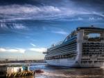 a huge cruise ship leaving port