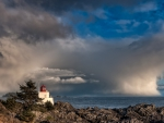 passing storm over lighthouse in ucluelet vancouver isl.