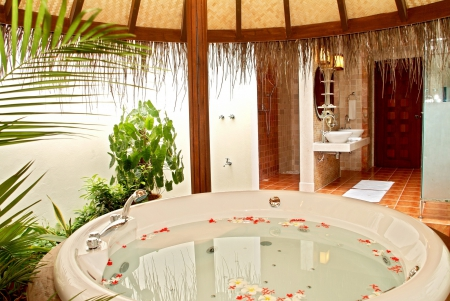 Outdoor Spa Bathroom - rose, bath, villa, outdoors, bathroom, flowers, beauty, outside, exotic, islands, holiday, relax, hot tub, paradise, bathe, spa, jacuzzi, island, petals, tropical