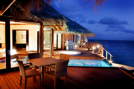 Water Bungalow at Night - polynesia, bungalow, dusk, sunset, villa, sea, lights, beach, lagoon, evening, swimming, night, exotic, islands, ocean, pool, water, paradise, spa, jacuzzi, island, tropical