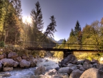 foot bridge over rocky mountain river hdr