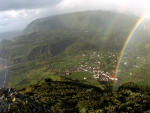 view from above of a rainbow over seaside village