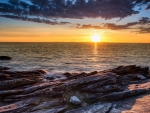 spectacular sunset over rocky seashore