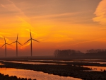 turbine windmills in motion at sunset