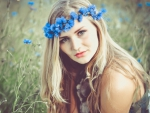 Beauty with a wreath of blue flowers