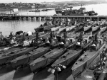 submarines moored on a river during wwII