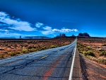 beautiful long road in monument valley hdr