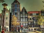 wonderful city block on a canal in amsterdam hdr