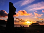 moai silhouette on easter island at sunset