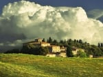 magnificent clouds over tuscan farm