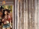 Cowgirl Outside A Barn