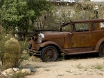 vintage rusted car in a desert town