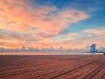 massive raked beach under gorgeous sky