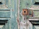 Rotten Door With a Rusty Lock