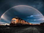 beautiful rainbow over a rail yard