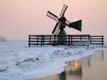 windmill by the river at winter