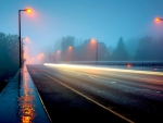 a highway bridge in a foggy rainy night