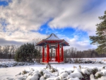 beautiful red oriental arbor in a winterscape